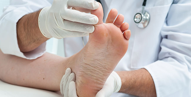 Physician examining patient's foot